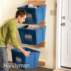 Recycling bins can take up too much floor space in the garage. These super-simple recycle bin hangers will get them up off the floor and out of the way.
