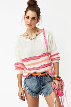 Lightweight ivory knit featuring a loose neon pink and coral stripe. Ribbed at cuff and hem, loose fit. Looks super cute tossed over a bikini and cutoffs!