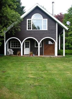 love the small porch with the arches and the big window on the second floor.