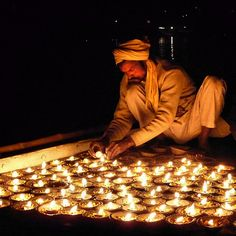 Candle Lighting on the Ganges #2 by Ron Rothbart