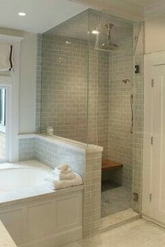 Same set up as us. Pony wall with glass - wall higher than tub; this one has counter decking, wainscoting on tub. SHORT CURB