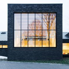 Omgeving's black brick library in Zoersel is subdivided into smaller blocks.
