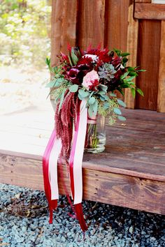Dramatic, rustic blush and burgundy bridal bouquet. Featuring garden roses, dahlias, calla lilies, amaranth, and succulents with trailing ribbon. www.flaurabotanica.com