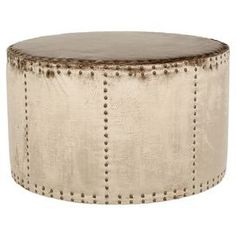 """Round ottoman with sage upholstery and nailhead trim.  Product: OttomanConstruction Material: Plywood and fabricColor: Antique sageFeatures: Nailhead trimDimensions: 20.1"""" H x 33.9"""" Diameter"""