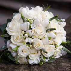 Sumptuous white piano roses with Bouvardia, Veronica and diamante pins. Because we all need a little sparkle!