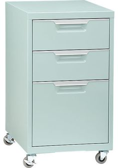 Find old filing cabinets, paint 'mint julep green' and add rollers