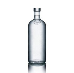 Absolut Vodka Technical : This bottle has a simplistic design like a pharmaceutical bottle with a cork. Communication : The choice is made to bring the product, the vodka, to the forefront. The product's quality speak for itself it doesn't need to be enhanced by a packaging.  Container : The bottle is in transparent glass with a cork colored in aluminum grey. 	Decoration : It is simple, it's an authenticity seal with a man on it and the label. All is in transparent glass.