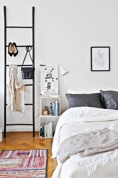 love the idea of using a ladder to hang up accessories and clothes for easy access