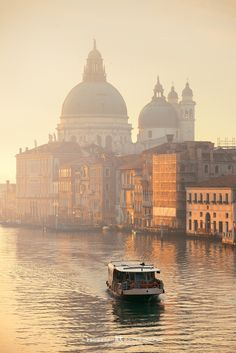 Misty Venice Canal - Website http://bestcityscape.com | 微信公众号: BestCityscape . Misty Venice Canal, Italy. A ferry boat drives in Venice canal in a misty morning. The series came from my 8-night-stay project in this magical Italian city.