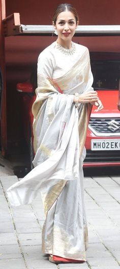 Malaika Arora in pearl and diamond necklace. All white look