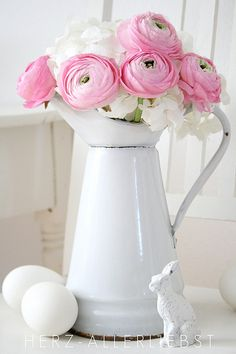 antique water pitcher and pink roses