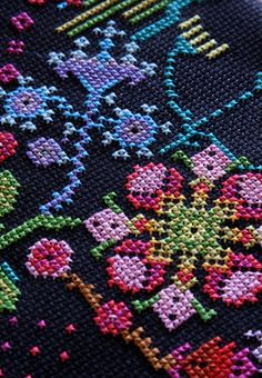 @Anna Marie Horner  I really want to try needlepoint sometime.  I love the black background.  It really makes the colors pop.