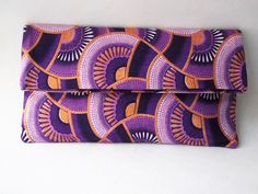 African print, Ankara, Printed Purple Fold Over Clutch Bag. £35,00, via Etsy.