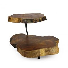 Two tier wooden tray with iron stand. The wood is an all natural teak. Given the natural design, this wood is hand carved in such a way that follows the pattern of the wood. This piece is perfect for