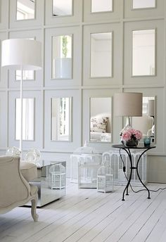 love this concept for the living area of a dark basement, to cheer things up and reflect more lght around.  wall of mirrors