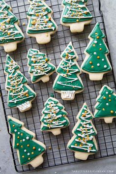 No chill sugar cookies Christmas trees decorated with royal icing and an assortment of sprinkles. This quick and easy cookie dough can Easy Sugar Cookies, Royal Icing Cookies, Sugar Cookies Recipe, Holiday Baking, Christmas Baking, Christmas Tree Cookies, Christmas Trees, Christmas Decor, Royal Icing Decorations