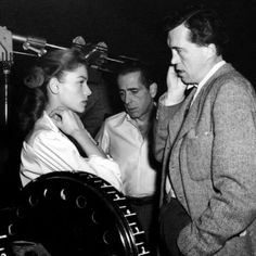 John Huston on the set of Key Largo with Humphrey Bogart and Lauren Bacall