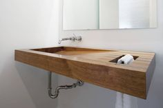 floating wood sink w/integrated towel bar.  Postcard House / Hufft Projects