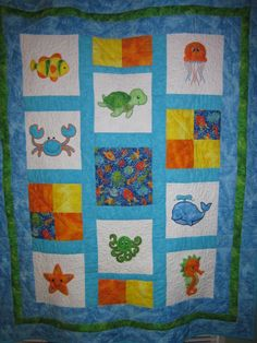 Baby quilt using applique quilt blocks made with my embroidery machine