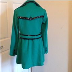 Bebe Green Leather Trim Flared Coat Beautiful feminine coat. Princess Cut that gives you an hourglass figure! Beautiful leather trim detail. Great condition! Missing two buttons, can be easily fixed. bebe Jackets & Coats Pea Coats