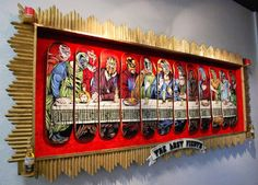 """""""'The Last Fiesta' is my 12-skateboard deck shout-out to Leonardo da Vinci's 'The Last Supper' with Jesus Christos and his 12 Luchador apostles getting down one last time. This piece was created for my solo exhibit Saints & Sinners, here at the Pale Horse Studio. Hand-made shadow box by Casey Paquet."""" - Chris Parks"""