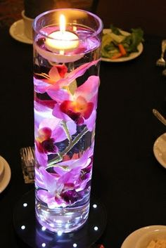 Top 5 DIY Centerpieces. I saw this at my aunty's wedding and I love this idea. It's simple but elegant.