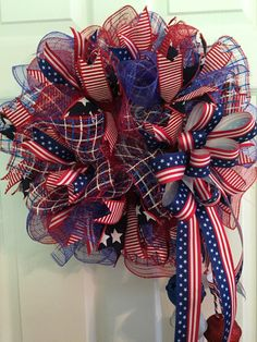 This wreath pops with red white and blue color. Show your patriotic pride on the Fourth of July, Memorial Day, Veterans Day, Presidents Day, Labor