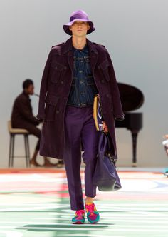 Tones of purple layered over an indigo denim jacket with a book print leather covered notebook
