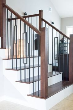 This design was created with the Aalto series plain bar (16.2.1) and the single rectangular balusters (16.6.3). These components are made of hollow wrought iron, and are available in a Satin Black (shown) or Ash Grey powder-coated finish. We offer parts, install services, and custom components throughout Texas. Click the image for more information.: