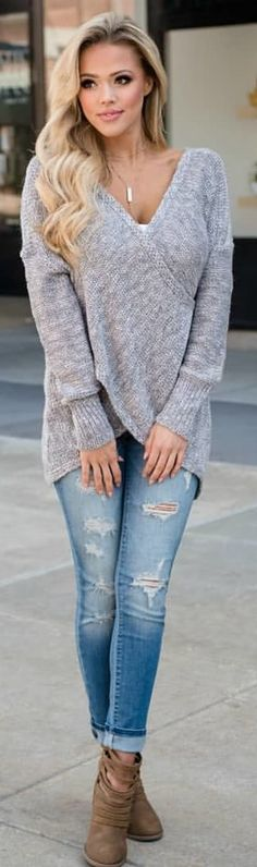 #winter #outfits v-neck sweater with distressed blue-washed jeans and pair of brown leather boots outfit