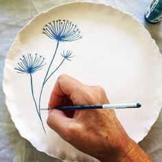 I am supposed to be thinking about dinner but instead I am painting dandelions #handmade #ceramics #pottery #plants