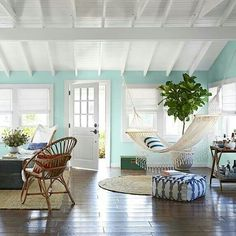 #Beach Houses & Cottages #Beige rugs lighten up the wood floor