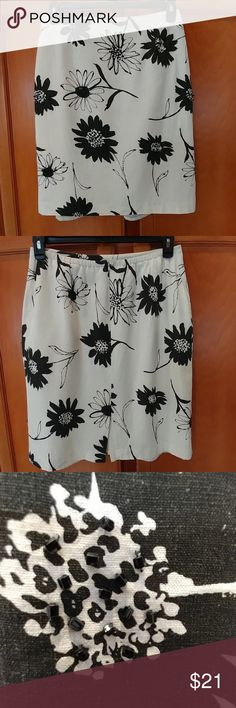 Cream and black floral skirt. This cute cream with black flowers skirt has  sequences in the middle of the flowers. It is a size 14.  Length is just over 22 inches  Waist is just about 15 inches Hips are 22 inches.  It has a hidden zipper and elastic waist. It is fully lined 100% polyester. The skirt is 55% linen and 45% rayon Skirts Midi