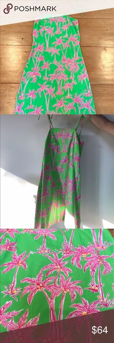 Lilly Pulitzer Palm Tree Dress This is an adorable dress by Lilly Pulitzer - perfect for spring and summer! It features a bright, lime green background with hot pink palm trees. The dress was only worn 1-2 times and is in excellent condition. It has a stretchy bust and zips up in the back. The shell of the dress is 100% cotton and the lining is polyester and cotton. Let me know if I can answer any questions 😇 Lilly Pulitzer Dresses