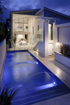 The long backyard of this home boasts an open patio and a large pool with fountains. Designed by http://www.daniellommadesign.com/