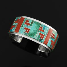 Cuff | Tommy Jackston (Navajo Diné).   Sterling silver, Natural Bisbee Turquoise and Coral.