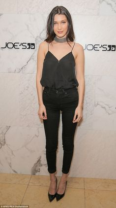 Model look: Bella, 19, showed off her incredibly slim figure in a pair of black skinny jeans rolled up at the bottom and a plunging black top with spaghetti straps