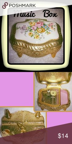 Vintage Music Box Brass/Porcelain - Japan-Sankyo.  Heavy ornate piece. Only flaw is  located on backside of box, hard to see. (Ding on the backside ) I do not know what song is played, but it works beautifully. Other