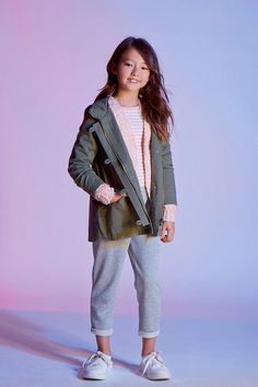 Forever 21 Girls - A woven hooded jacket featuring a button and zipper front, long raglan sleeves with button cuffs, two front flap pockets, and two mock chest pockets.