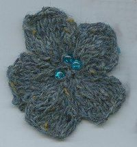One of the best knitted flower patterns I've found.  Perfect for a little (or big) girl's headband or hat.