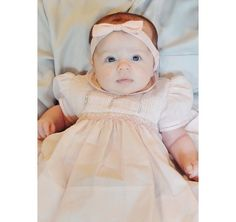 What a little doll baby looking absolutely adorable in her vintage Feltman Brothers dress!