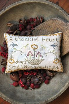 Prim Stitchery Pillow...and old wooden bowl.  A Thankful Heart, November 2012, Heartstring Samplery.