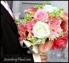 Pretty pink, ivory, and green bridal bouquet featuring roses, calla lilies, gerbera daisies, and pearls.