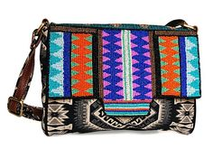 Crafted in jacquard, with a brightly hued beaded flap, this cross body shoulder bag with an adjustable strap is trimmed with faux leather.