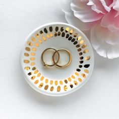 White and Gold Ceramic Ring Dish Gold Mosaic  I made this ring dish out of a slab of clay, and painted the 22k gold accents by hand. Use these for jewelry dishes or tea light holders. • Approx. 3 wide each • Ready to ship • Complimentary gift box  You can see all of my jewelry dishes here: https://www.etsy.com/shop/ModernMud?section_id=15352879&ref=shopsection_leftnav_2  To see all of my items, go back to my shop: https://www.etsy.com/shop&#x2F...