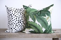 """A fabulous, banana leaf pillow in fresh shades of green with creamy white and black with a small touch of yellow. Size: 20"""" x 20""""Made in Canada 100%…"""