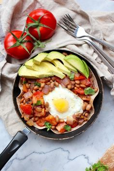 It's not a proper brunch without a Healthy Huevos Rancheros at the table amongst the regulars, like avocado toast and green juice. This Latin American dish of eggs, fried or poached is topped with a spicy tomato sauce and served on a fried corn tortilla with veggies and cheese. YUM!