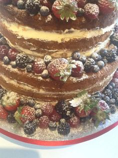 'Naked' Wedding Cake 3 tiers, victoria sponge filled with raspberry jam and buttercream. Decorated with strawberries, raspberries and blackberries #weddingcake #fruit #alternativewedding