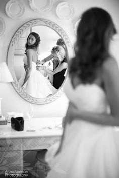Bride looking in the mirror, getting ready for her wedding at the Piedmont Driving Club in Midtown Atlanta.:
