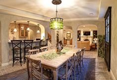 Mediterranean basement by M.J. Whelan Construction - angle from the other side of the room.  Love the wine bottle chandelier!